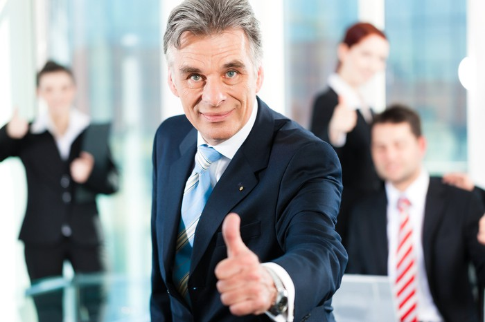 business people giving the thumbs up