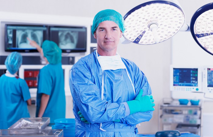 A surgeon standing in an operating room