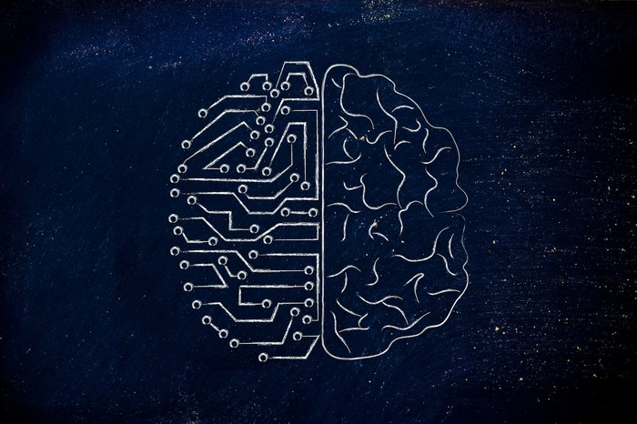 Microchip and human brain graphic next to each other.