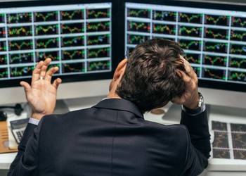 frustrated-stock-traders-multiple-charts-forecasting-getty_large