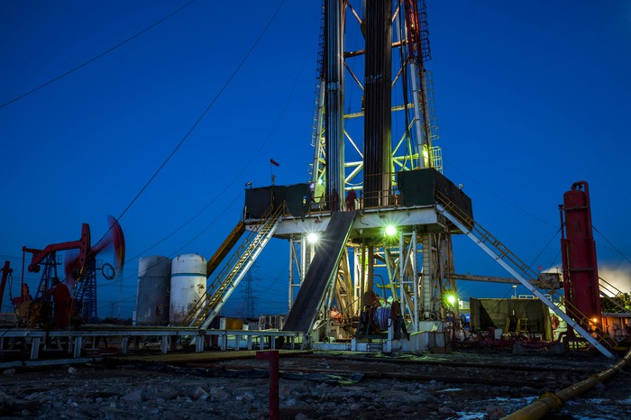 An oil drilling rig with pump jacks.