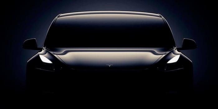 Black Model 3 teased in Tesla's event invitation art