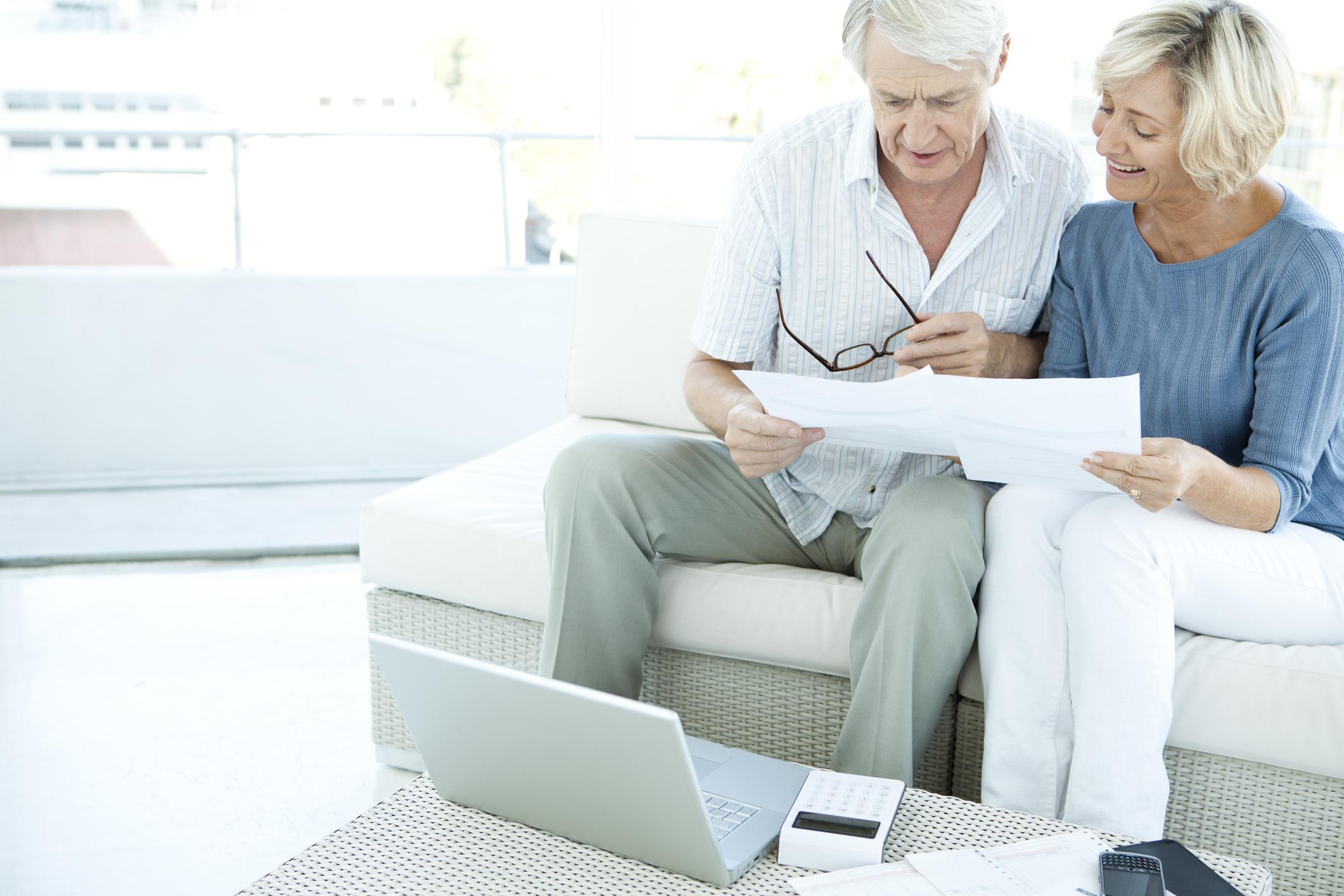 Senior couple reviewing a retirement plan