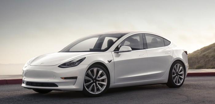 A Tesla Model 3 in white.