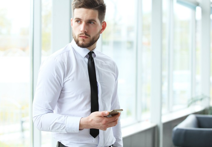 Man in dress shirt and tie