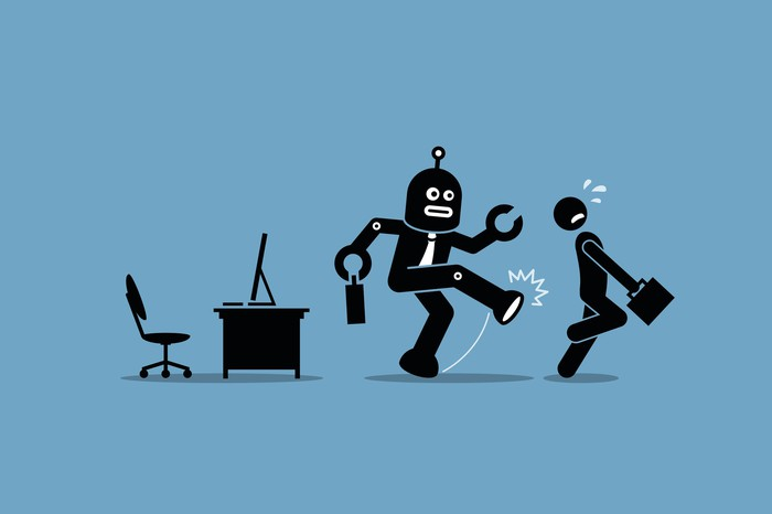 A robot worker kicks a human out of its office.