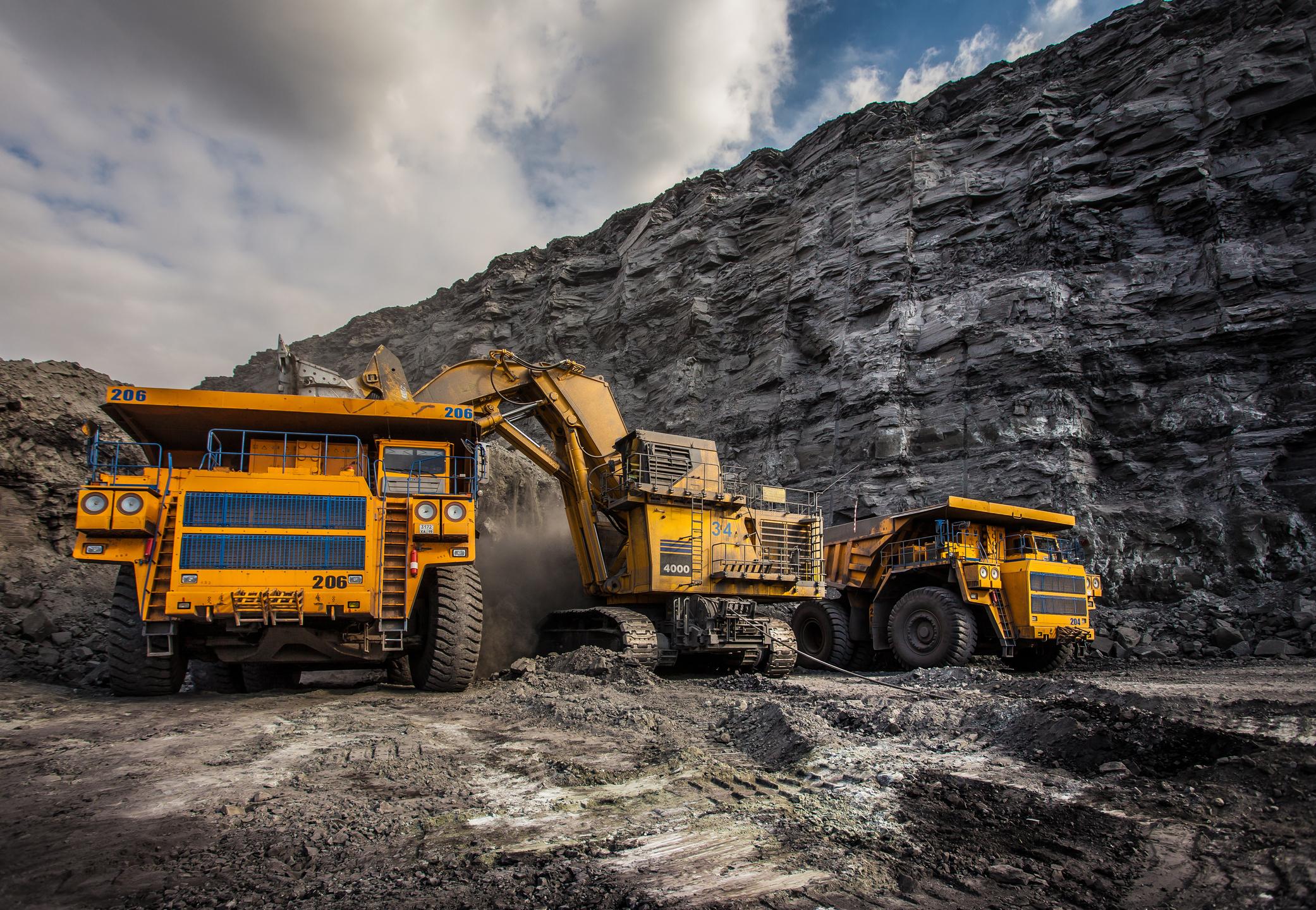 Loading trucks with coal.
