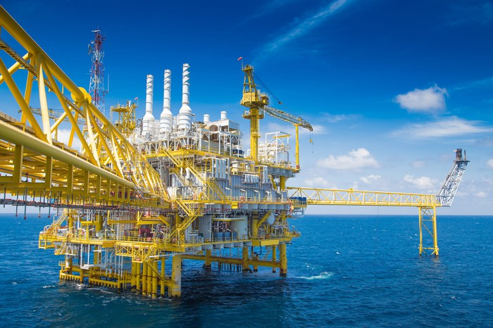 An offshore rig drills for oil.