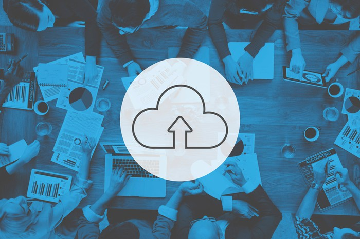 Cloud computing concept of data shared at a conference table.