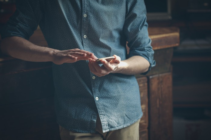 A man using a touchscreen smartphone.