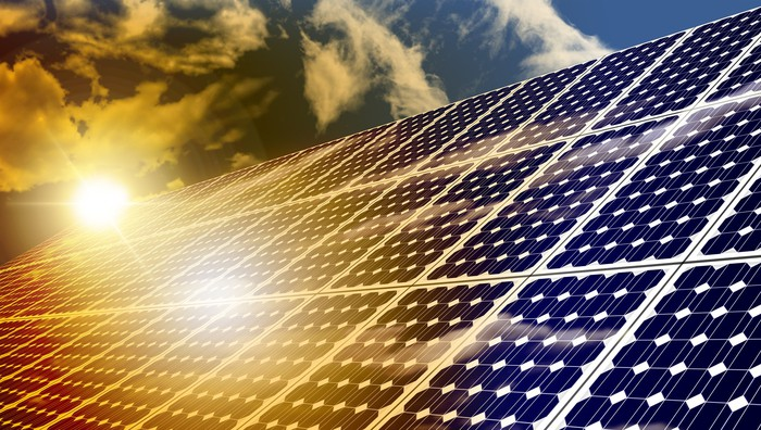 Solar panels absorbing the suns energy on hot summer day.