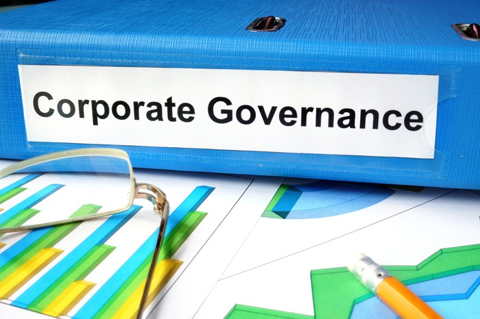 Binder with Corporate Governance written on it