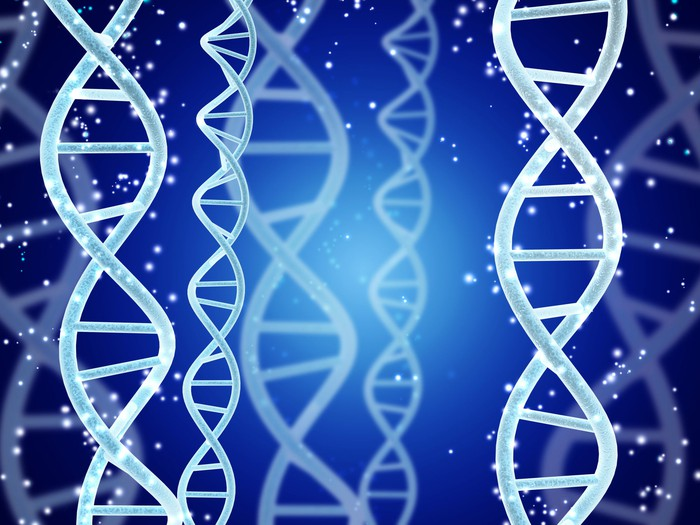 Digital models of DNA structure and sparks on abstract blue background.