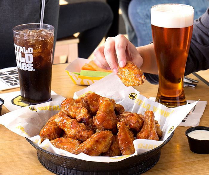 Servings of traditional chicken wings and beer