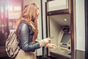 atm bank cash woman getty