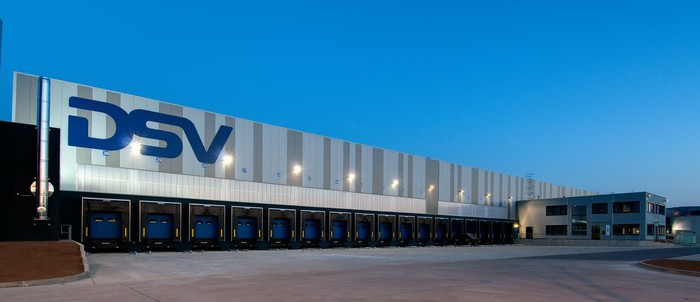An industrial distribution property in Europe, with the letters DSV on the side of the building.
