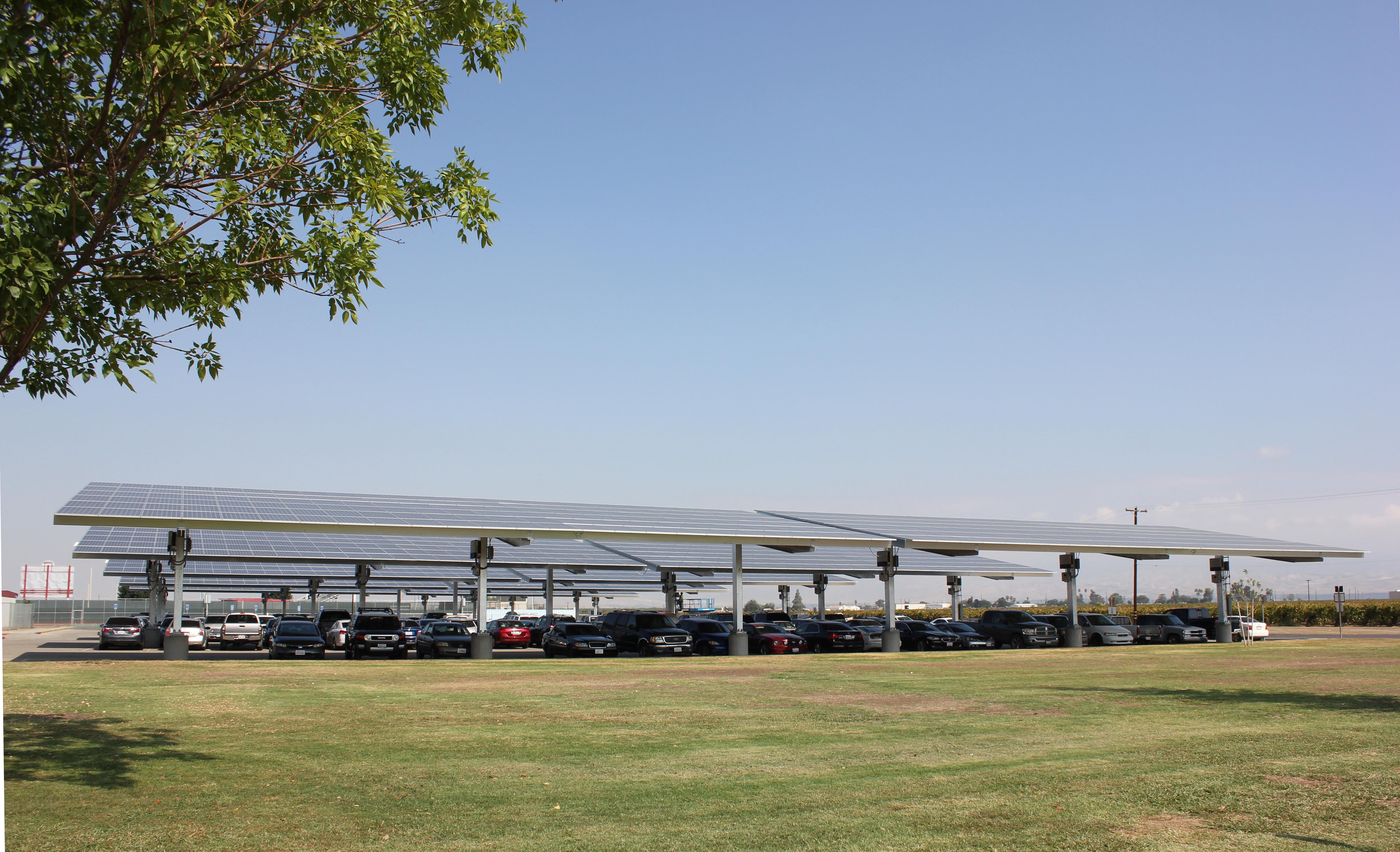 Carport shown with SunPower solar panels on them, providing solar energy and shade for cars.