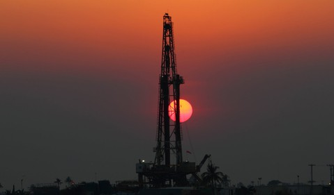 Drilling rig with the setting sun.
