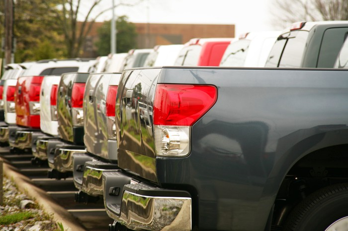 Trucks lined up at a dealership lot