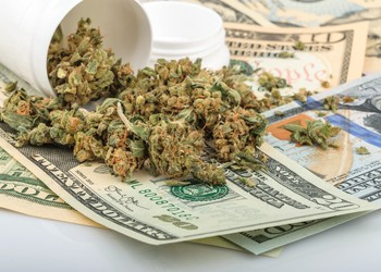 Marijuana on Top of Money Getty