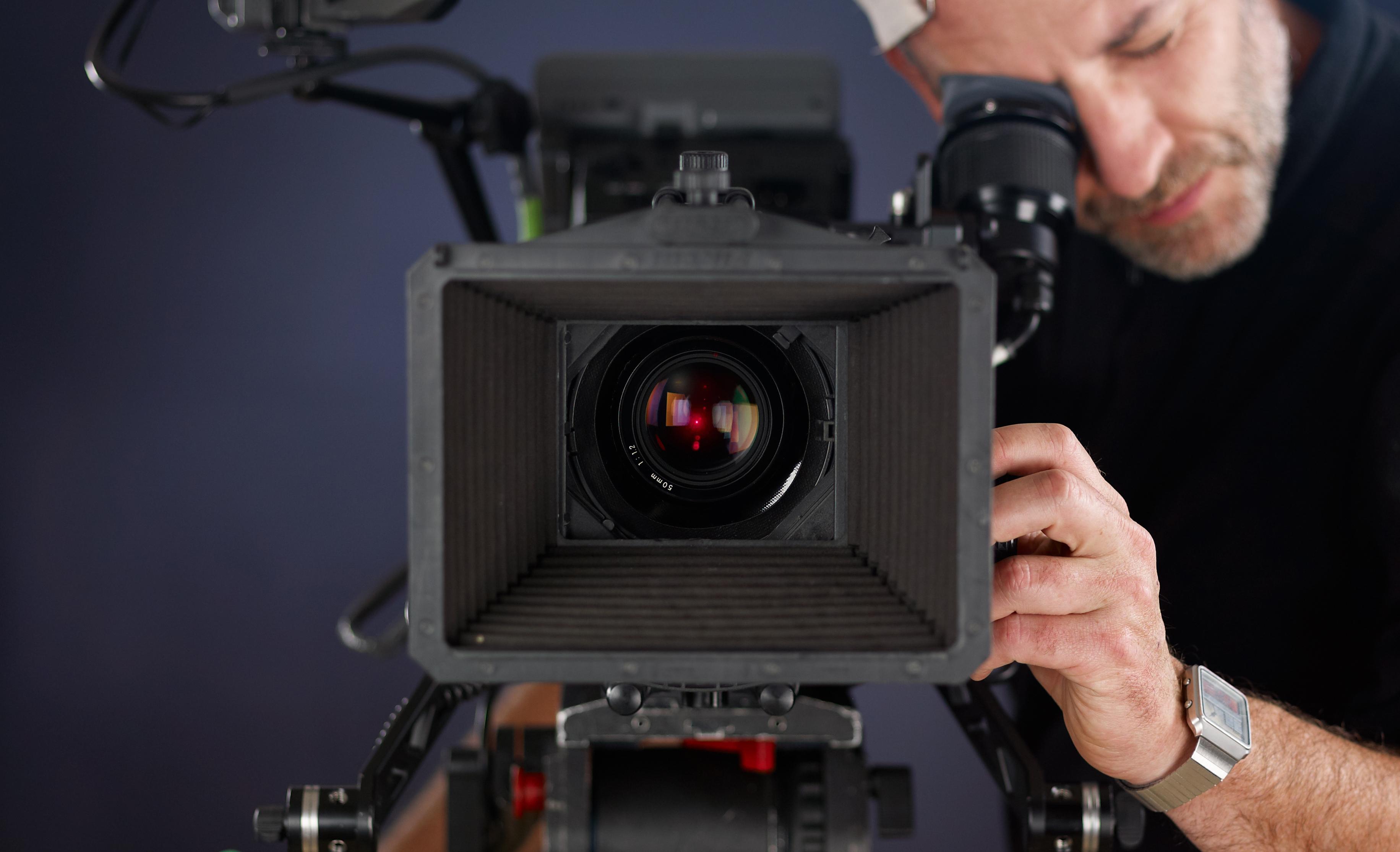 Cameraman behind a cinema camera