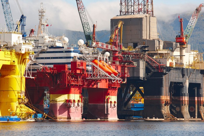Several oil drilling rigs at dock