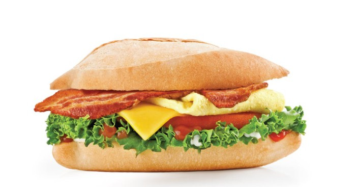 Sandwich of bacon, egg, lettuce, cheese, and mayo served on a french roll.