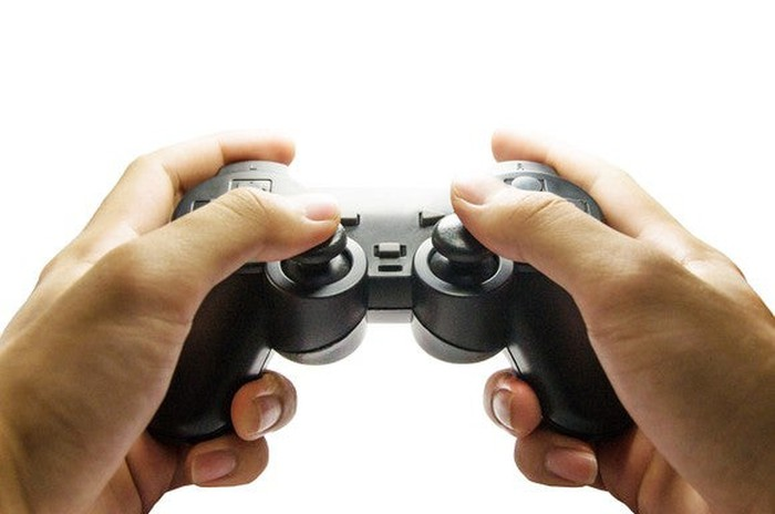 A person using a video game controller.