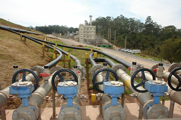 Compressors and pipelines gathering renewable biomethane from a landfill.