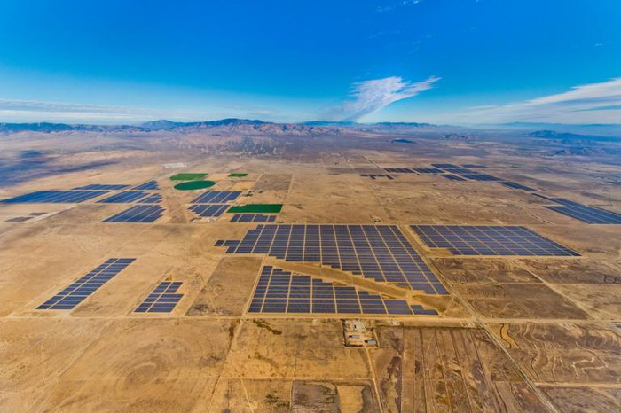 Aerial view of the Solar Star project with mountains in the background.