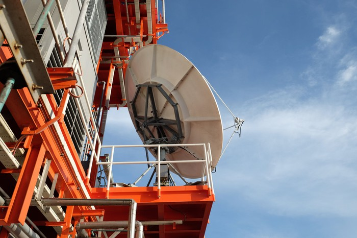 A satellite dish on an offshore oil rig.