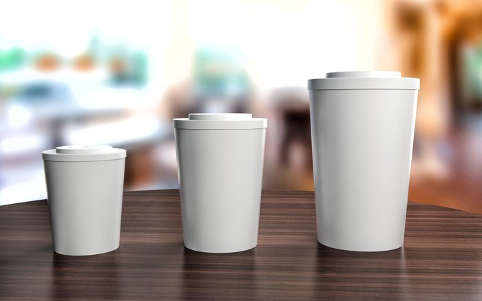 Three coffee cups placed in order of increasing size from left to right