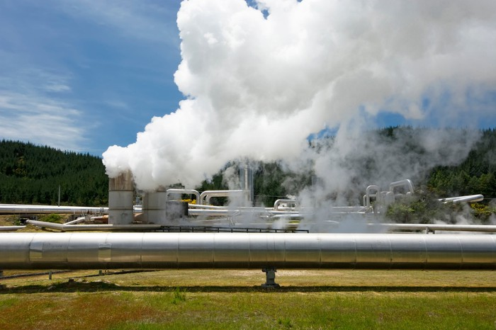 An operating geothermal power plant in daylight