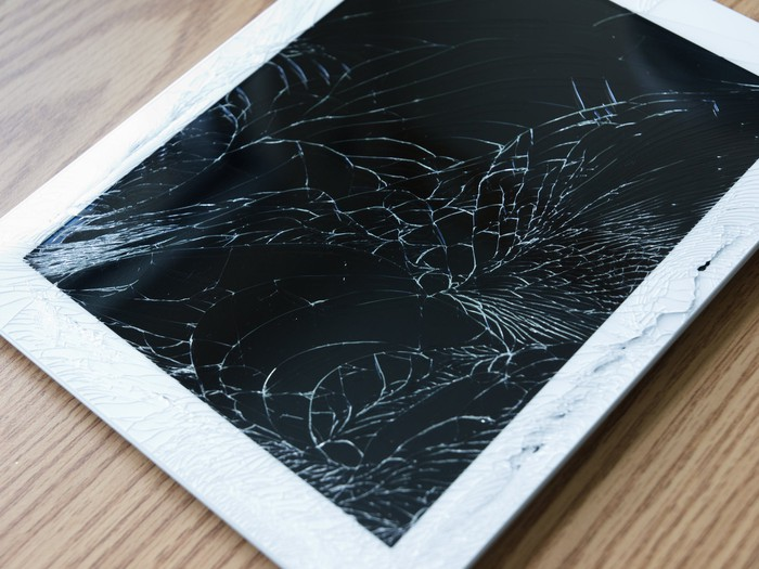 A tablet computer with a shattered screen.