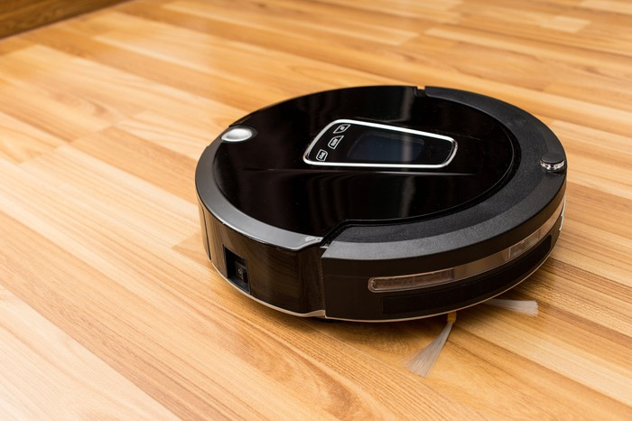 iRobot's Roomba cleaning a hardwood floor.