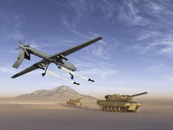 Illustration of a drone firing rockets at a tank.