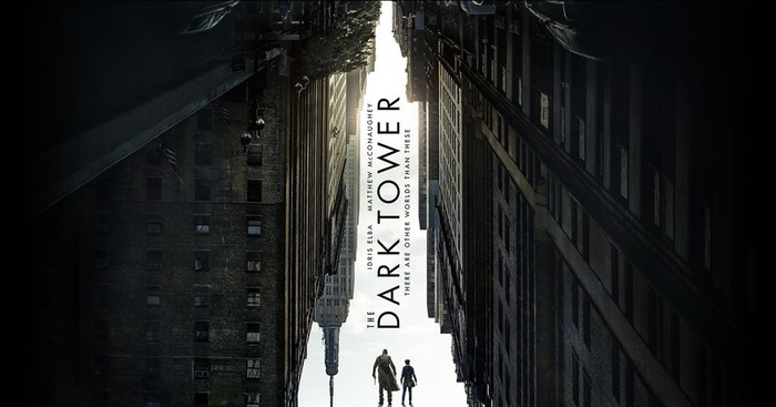 """Poster for Sony's """"The Dark Tower"""" with two characters walking between skyscrapers and the negative space creating the image of a tower."""