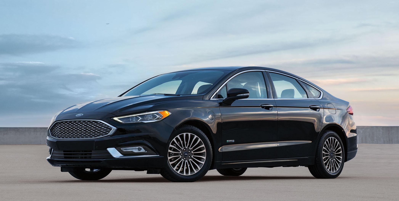 A black 2017 Ford Fusion Energi sedan.