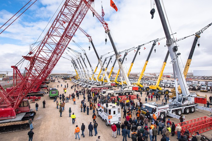 Live auction of massive heavy industrial equipment.