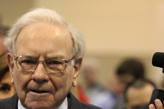 Warren Buffett walking through the crowd at the Berkshire Hathaway annual shareholder meeting.