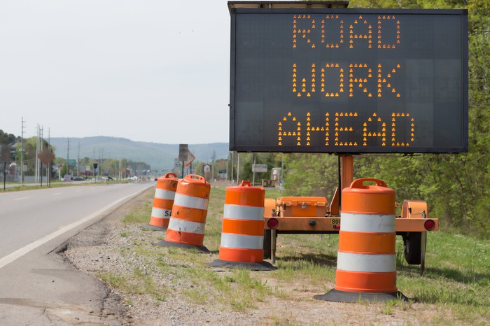 Road work ahead sign on the side of the road.