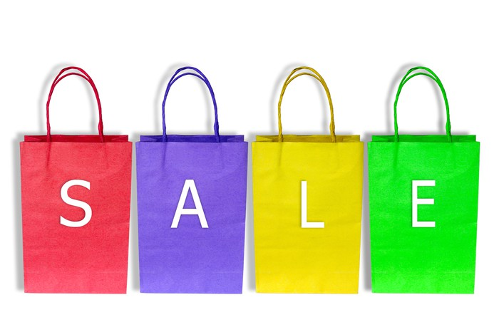 Shopping bags of different colors spelling out the word sale
