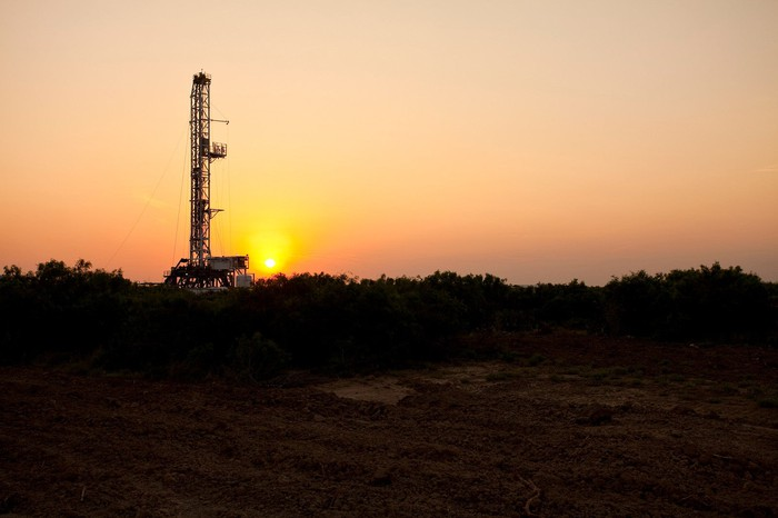 A drilling rig in the Eagle Ford Shale at sunset.
