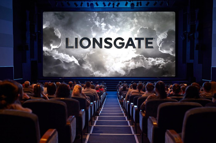 Packed movie theater with the Lionsgate logo being projected on the silver screen