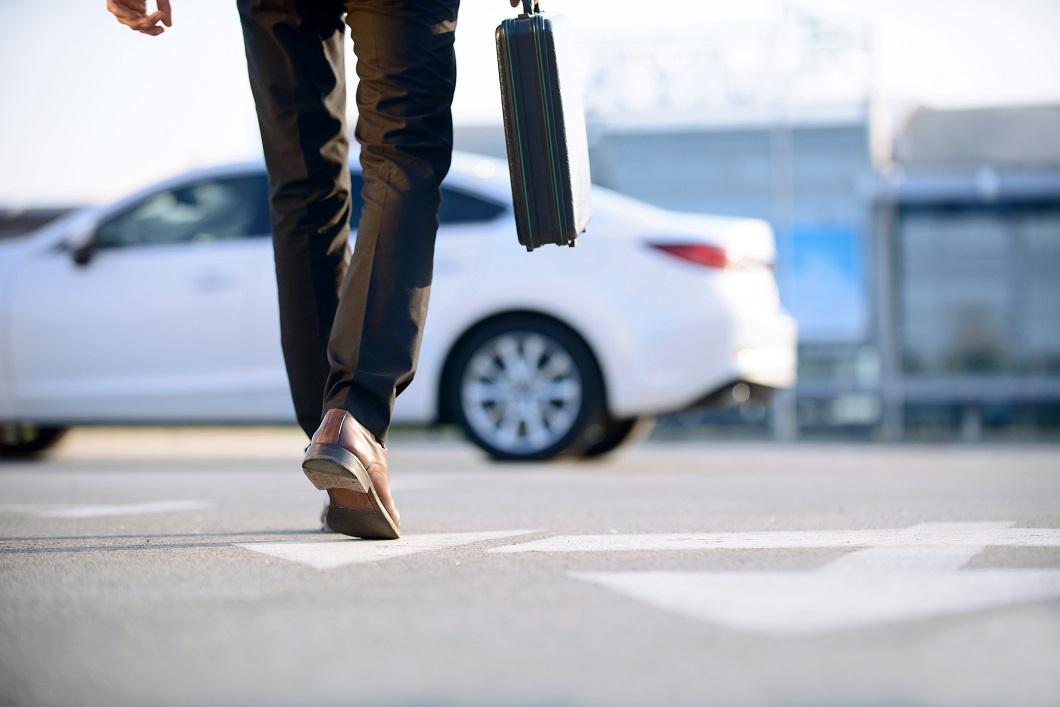 Businessperson walking to car.