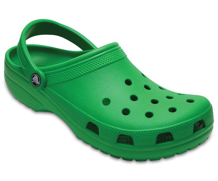 A Crocs classic clog in green.