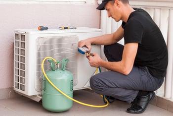 Man Fixing Air Conditioner
