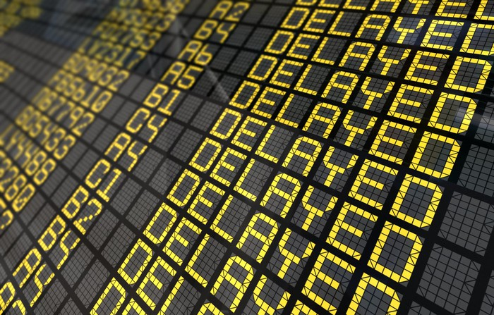 "An electronic display showing the word ""delayed"" multiple times"