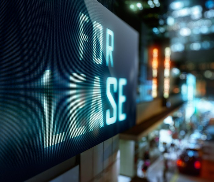 "Electronic sign, reading ""for lease""."