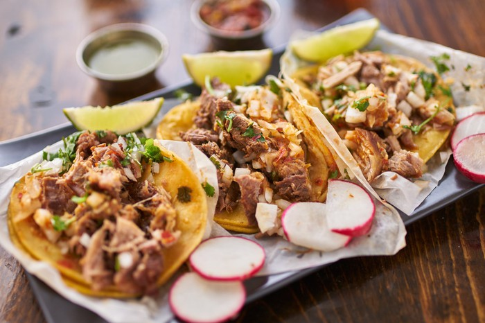 Three pork tacos.